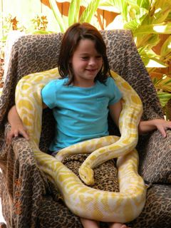 8 year old Grace with 8 year old python
